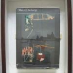 "G.P. MUTOID ""Après_Duchamp"", 2001 Tecnica mista con libro originale, cm 36x45"